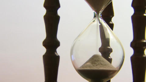 Hourglass clock counting the time Live Action