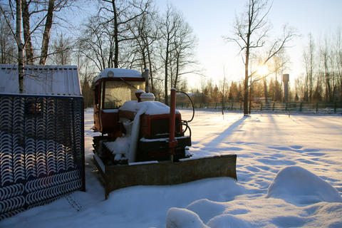 Tractor in the parking lot covered with snow フォト