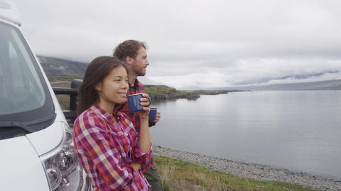 Travel couple by mobile motor home RV campervan motorhome on Iceland Footage