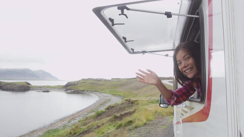 Travel woman in mobile motor home RV campervan waving hand saying hello hi Live Action