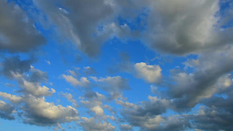Timelapse of dark stormy clouds with blue sky in background Footage