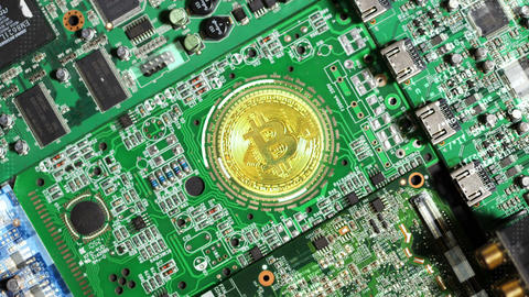 Slow Motion Bitcoin Coin Located on Computer Circuit Boards Footage