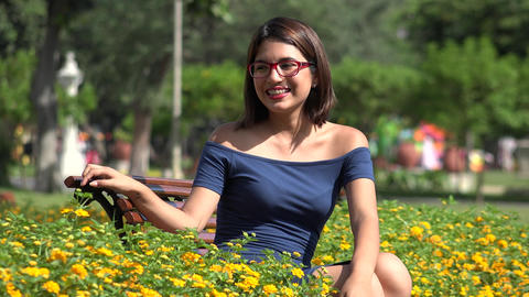 Pretty Teen Girl In Park With Braces And Eyeglasses Footage