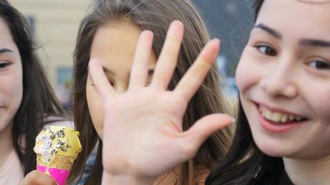 Closeup Smiling Girls Eat Ice-Cream Play Tricks to Camera Footage