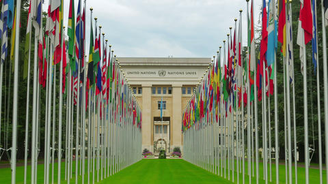 United Nations building with flags, Geneva, Switzerland, 4K Footage