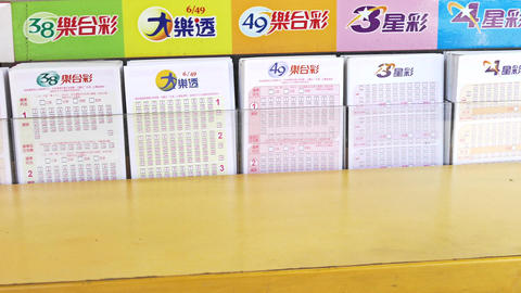 Lottery tickets at store counter, 4K Footage