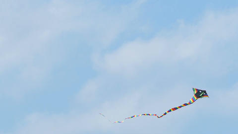 Colorful kite flying in sky Footage