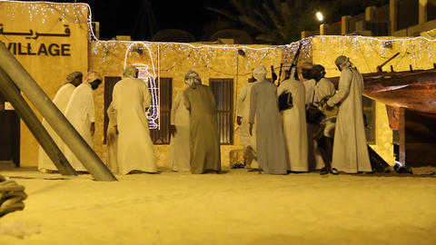 Group of Arab men sing and play traditional rhythmic music, heritage village Footage