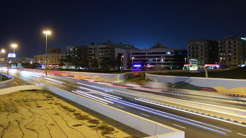 Recessed roadway at city junction, bustling traffic at night, time lapse Footage