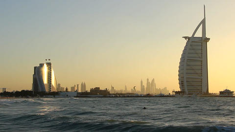 Jumeirah Beach Hotel And Burj Al Arab From Sunset Beach At Evening stock footage