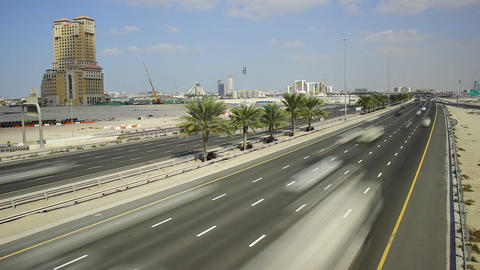 Highway through deserted area, day traffic time lapse. Continuous vehicle flow Footage