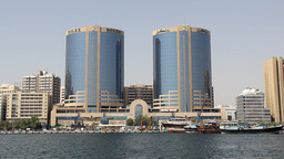 Twin Tower building and shopping complex at Dubai Creek shore, daytime view Footage