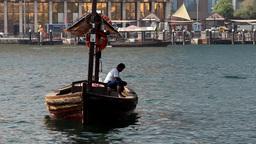 Abra boat driver sit on vessel bench lean down, ferry on break, drift freely Footage