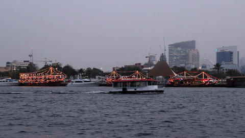 Three dhow boats, floating restaurants, stay at berth, Bur Dubai shore of creek Footage