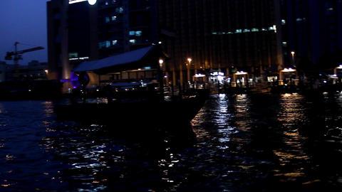 Parallax shot around Abra boat on Dubai Creek at darkness, black silhouette Footage