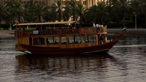 Pleasure cruise dhow boat sail on water, close view tracking shot Footage