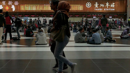 Taipei Train Station slow motion people walking across foreground Live Action