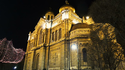 Motion background middle shot at Varna Cathedral at night with lights on Footage
