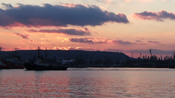 Slow motion long shot of Varna harbour at sunset pink sky with darker clouds Footage