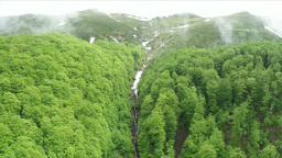 Flying straight into the mountain over the ravine Footage