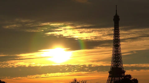 The Eiffel Tower in Paris. Sunset France Live Action