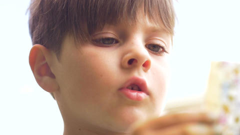 Close up of a preschool aged boy thinking and concentrating while learning in Footage