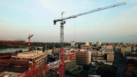 WARSAW, POLAND - SEPTEMBER 27, 2017. Aerial descending shot of tower cranes at Footage