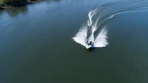 Aerial shooting wake surfing on the river Footage