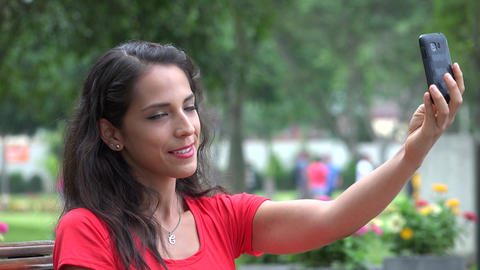 Happy Hispanic Woman Taking Selfy Footage