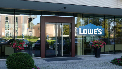 Glass facade of a modern office building with Lowe''s logo. Editorial 3D Live Action