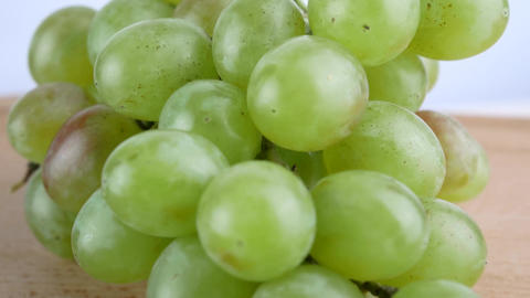White Grapes Grone Spins On Wooden Surface Footage