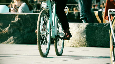 Unknown people riding classic bicycles on the street Footage