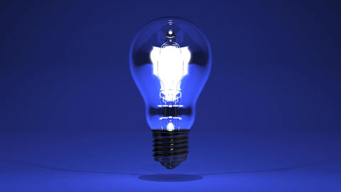 Electric Bulb On Blue Stock Video Footage