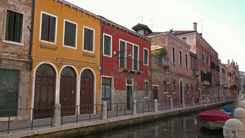 Multi-colored houses on canal in Venice, Italy, 4k Footage