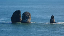 Seascape of Kamchatka Peninsula: Three Brothers Rocks in Pacific Ocean Footage