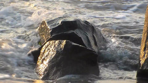 Waves beat against the rocks on the shore of the sea Footage