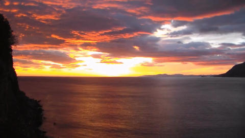 color sunrise from sea over clouds in Laredo, North Spain.Timelapse.Accelerated Footage