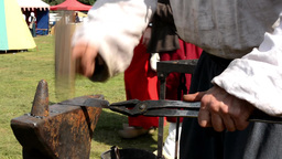 blacksmith works in the forge at the exhibition - fire and smoke - people Footage