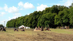 ancient battlefield - cannons - tents in the background - forest (trees) - sunny Footage