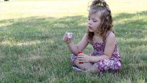 little girl blowing bubbles Footage