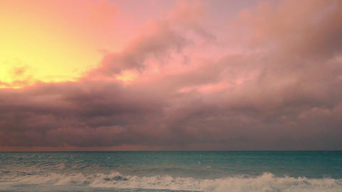 Stormy ocean landscape with sunset clouds and splashing waves Footage