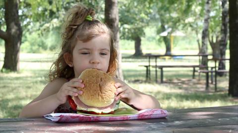 little girl eat big sandwich Footage
