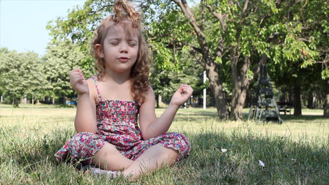 little girl meditates Footage
