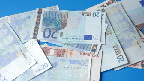 1080p Ungraded: Euro Banknotes Falling Down to Blue Table Footage
