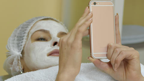 Woman With Facial Mask Browsing Internet Live Action
