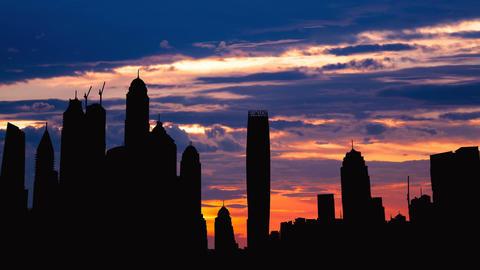 Timelapse of Dubai marina cityscape silhouette on sunset in UAE Footage