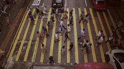 People mass on the pedestrian cross in peak hour. Crowded area from the top Filmmaterial