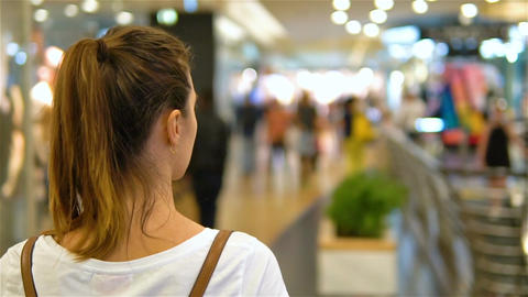 Young Woman Exploring Modern Shopping Mall In Slowmotion Live Action