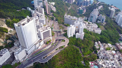 Aerial pan from Queen Mary Hospital to Sandy Bay at bottom of Victoria peak Footage