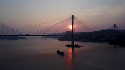 Dark silhouette of large bridge against sunset, impressive Hong Kong pictures Live Action